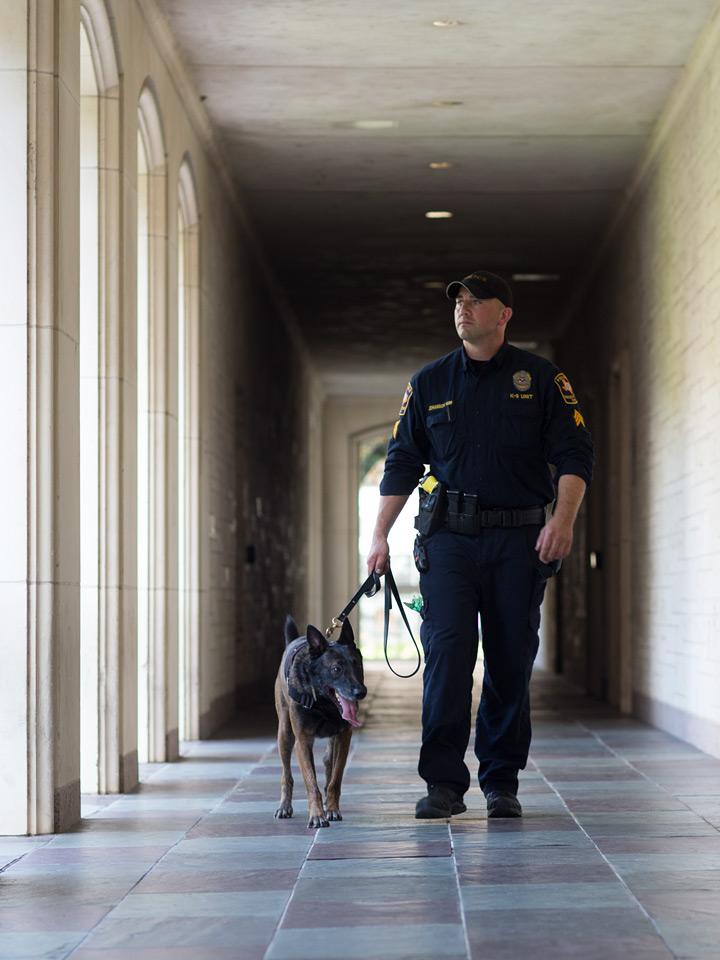 K9 dog and handler walking in hallway
