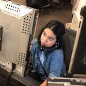 a female UTPD dispatcher handles a call